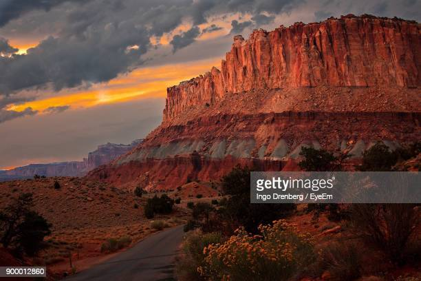 scenic view of mountain against cloudy sky - capitol reef national park stock pictures, royalty-free photos & images