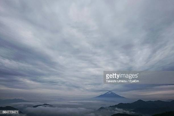 Scenic View Of Mountain Against Overcast Clouds