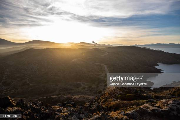 scenic view of mountain against sky during sunset - roses catalonia stock pictures, royalty-free photos & images