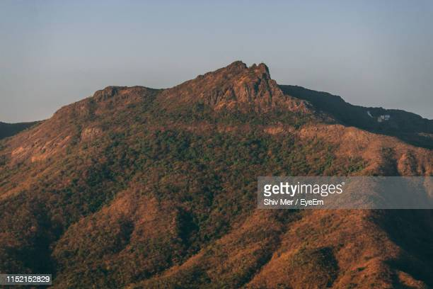 scenic view of mountain against sky - junagadh stock photos and pictures