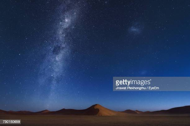 Scenic View Of Mountain Against Star Field At Night