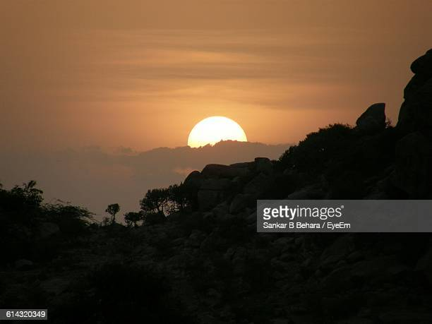 Scenic View Of Mountain Against Sun During Sunset
