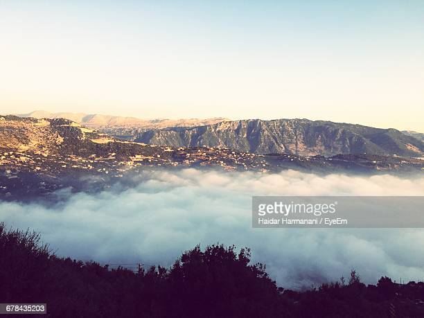 Scenic View Of Mountain And Clouds Against Sky