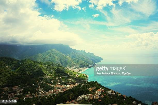 Scenic View Of Mountain And Sea Against Sky