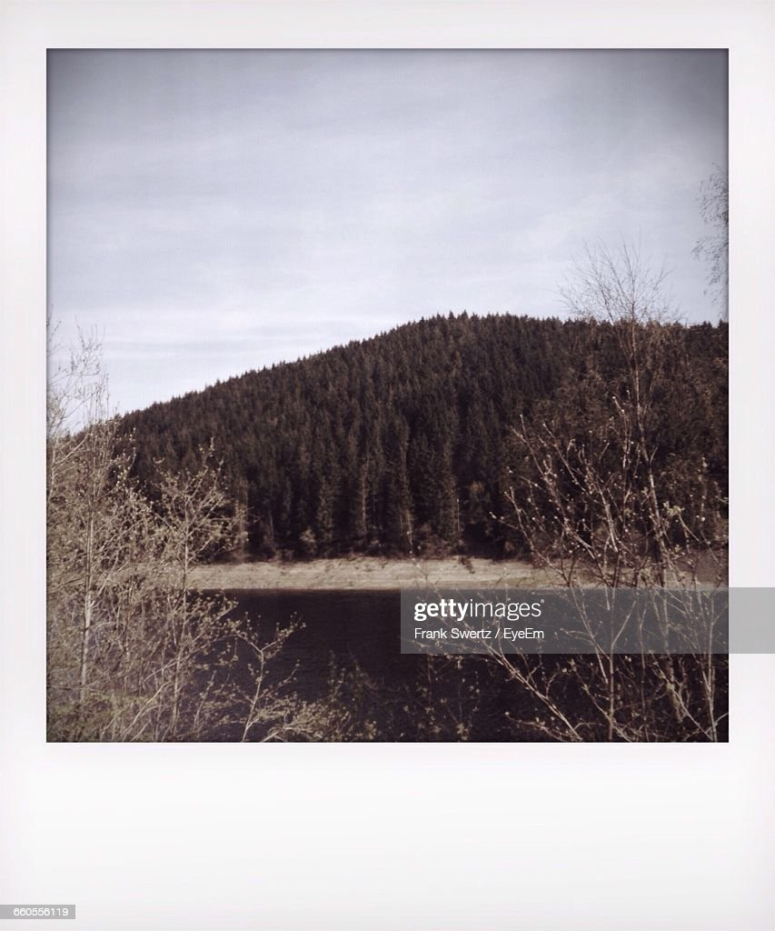Scenic View Of Mountain By River Against Sky : Stock-Foto