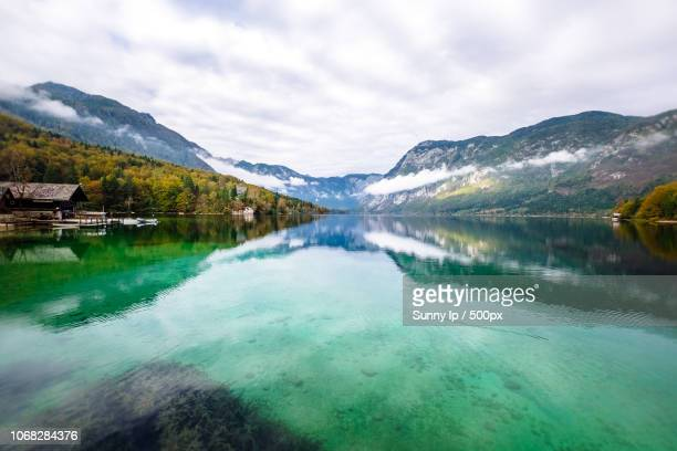 scenic view of mountain crystal clean lake in diminishing perspective - slovenia stock pictures, royalty-free photos & images