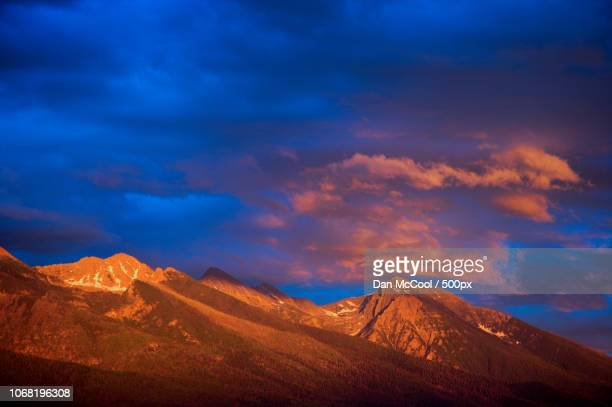 Scenic view of mountain peak at sunset