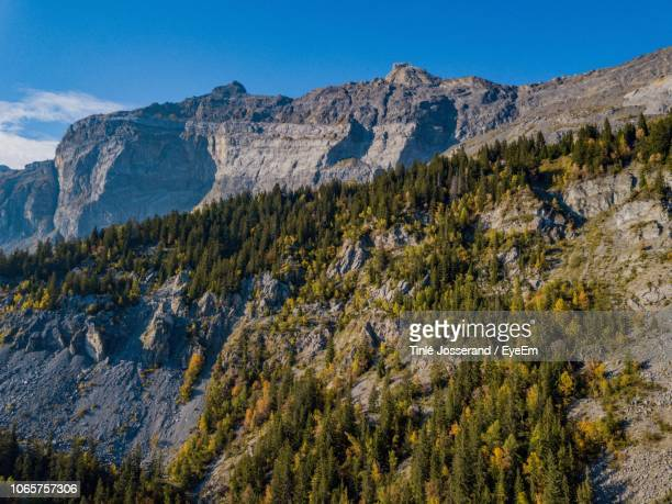 scenic view of mountain range against blue sky - sallanches stock pictures, royalty-free photos & images