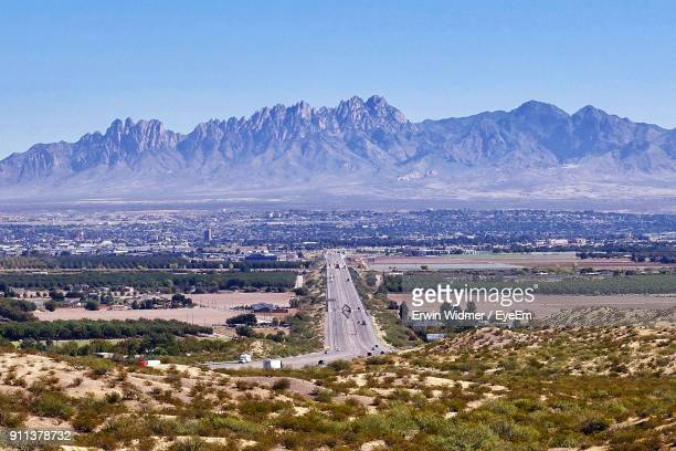 scenic view of mountain range against blue sky - las cruces new mexico stock pictures, royalty-free photos & images