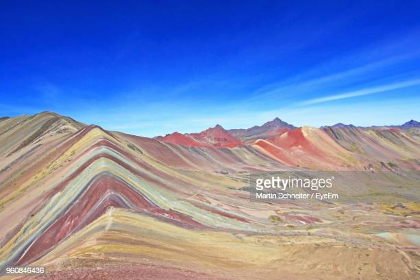 scenic view of mountain range against blue sky - peru stock pictures, royalty-free photos & images