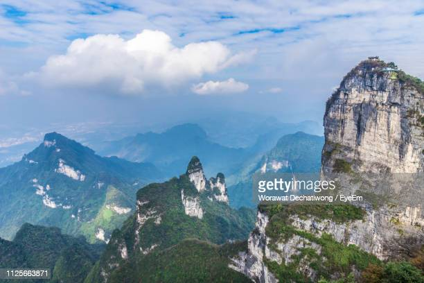scenic view of mountain range against cloudy sky - changsha stock pictures, royalty-free photos & images