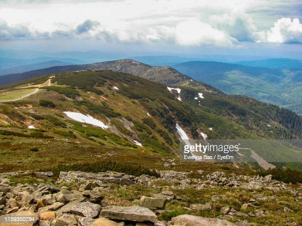 scenic view of mountain range against cloudy sky - babia góra mountain stock pictures, royalty-free photos & images