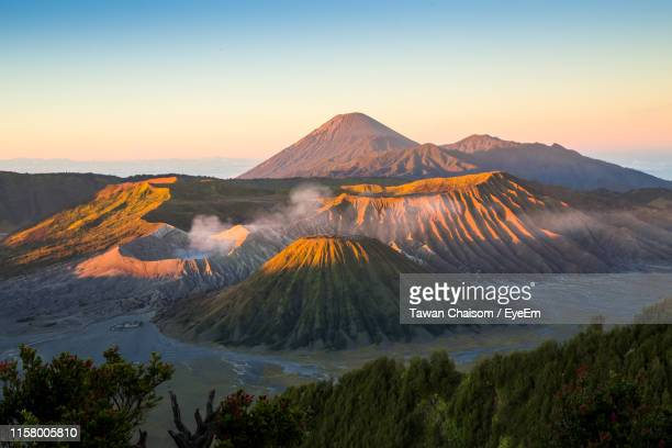 scenic view of mountain range against sky during sunset - bromo tengger semeru national park stock pictures, royalty-free photos & images
