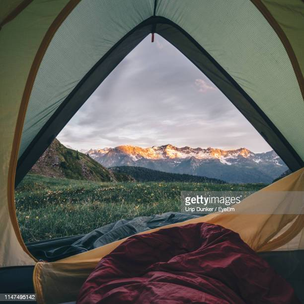 scenic view of mountain range against sky seen through tent - tent stock pictures, royalty-free photos & images