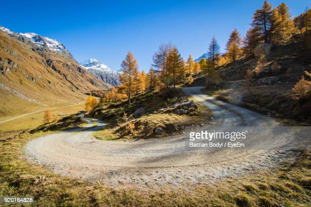 Scenic View Of Mountain Road Against Blue Sky