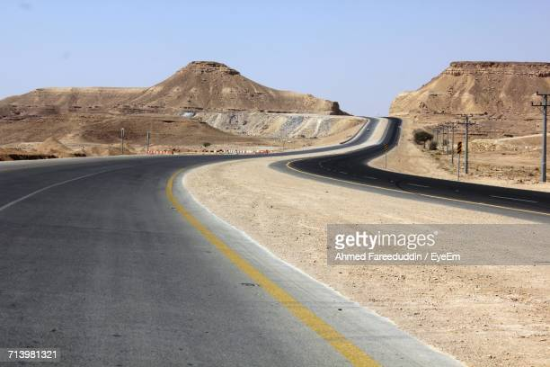 Scenic View Of Mountain Road Against Clear Sky