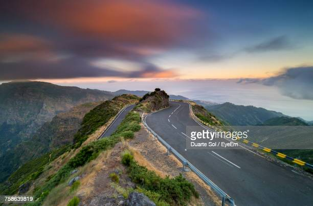 Scenic View Of Mountain Road Against Sky During Sunset
