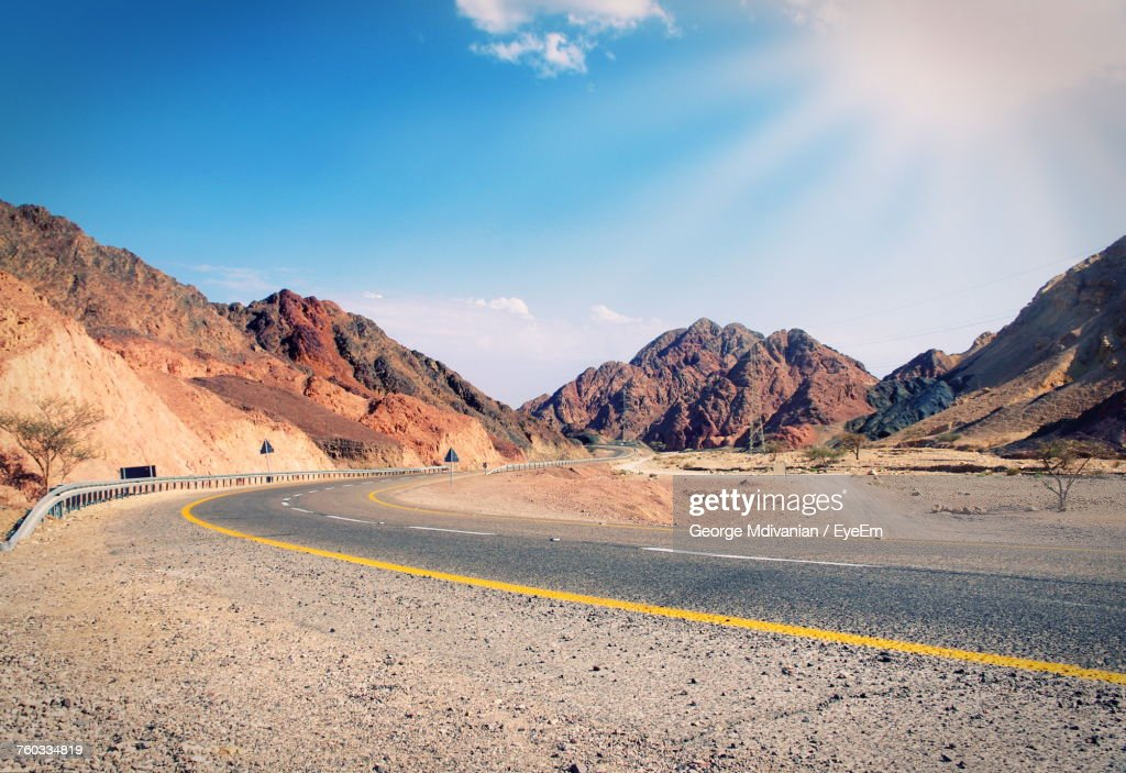Scenic View Of Mountain Road Against Sky : Stock Photo