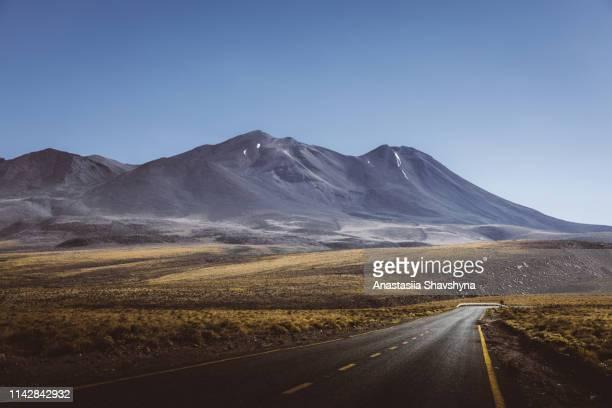 scenic view of mountain road in atacama desert - mountain range stock pictures, royalty-free photos & images