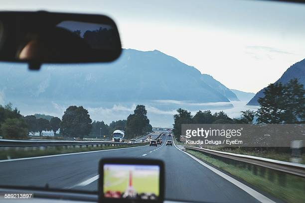 Scenic View Of Mountain Seen Through Windshield