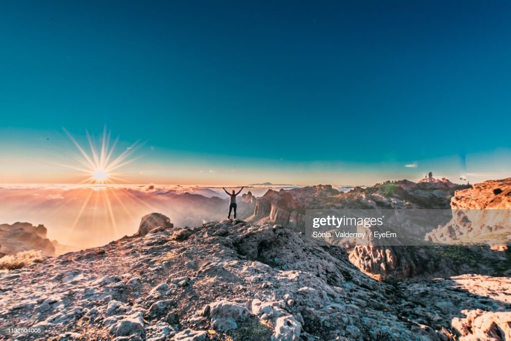 Scenic View Of Mountains Against Blue Sky During Sunset : Stock Photo