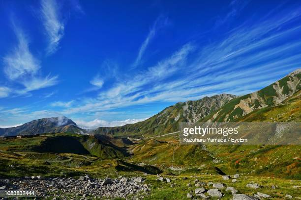 scenic view of mountains against blue sky - 山岳地帯 ストックフォトと画像