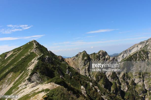 scenic view of mountains against blue sky - 長野市 ストックフォトと画像