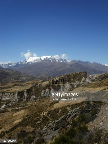 scenic view of mountains against blue sky - linda fraikin stock pictures, royalty-free photos & images