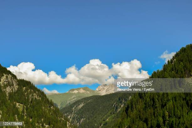 scenic view of mountains against blue sky - principality of liechtenstein stock pictures, royalty-free photos & images