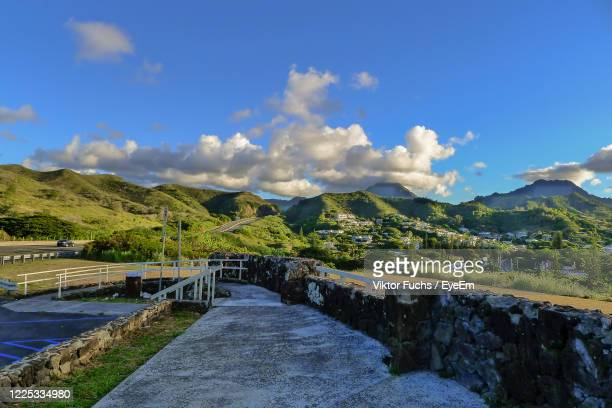 scenic view of mountains against blue sky - kailua stock pictures, royalty-free photos & images
