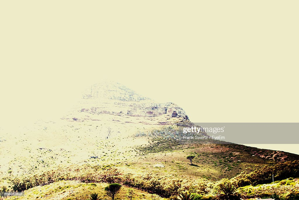 Scenic View Of Mountains Against Blue Sky : Stock-Foto