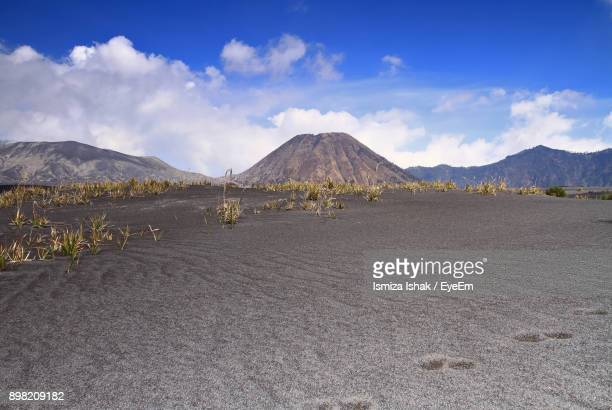 scenic view of mountains against blue sky - surabaya stock pictures, royalty-free photos & images