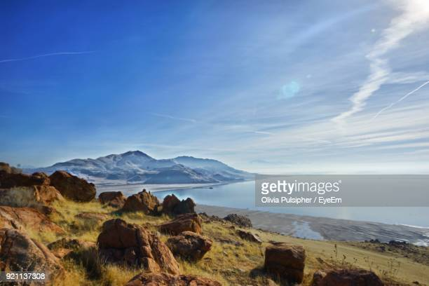 scenic view of mountains against blue sky - great salt lake stock pictures, royalty-free photos & images