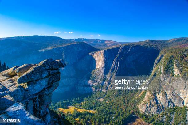 scenic view of mountains against blue sky - yosemite valley stock photos and pictures