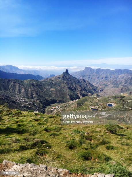 scenic view of mountains against blue sky - atlantic islands stock photos and pictures