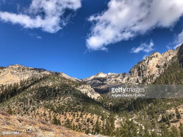 scenic view of mountains against blue sky - mt charleston stock photos and pictures
