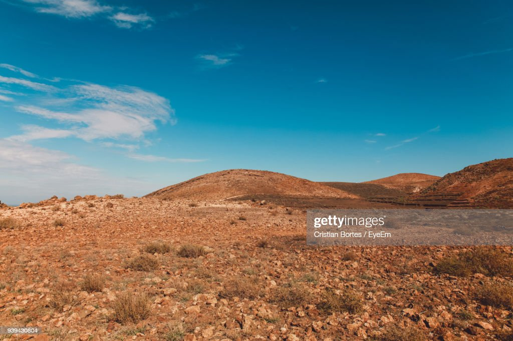 Scenic View Of Mountains Against Blue Sky : Stock Photo