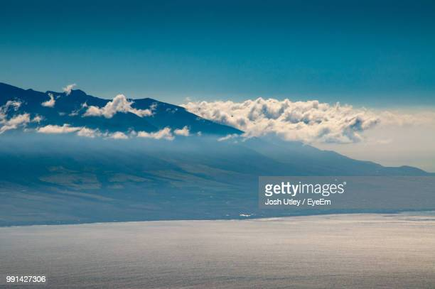 scenic view of mountains against blue sky - josh utley stock pictures, royalty-free photos & images
