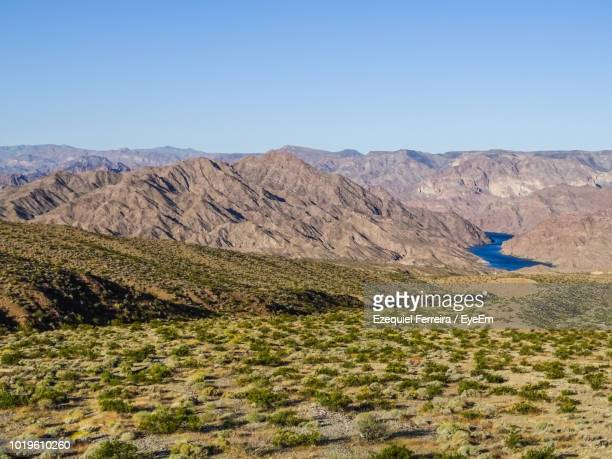 scenic view of mountains against clear blue sky - boulder city stock photos and pictures