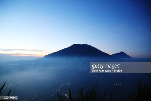 scenic view of mountains against clear blue sky - dewi fatmayanti stock photos and pictures