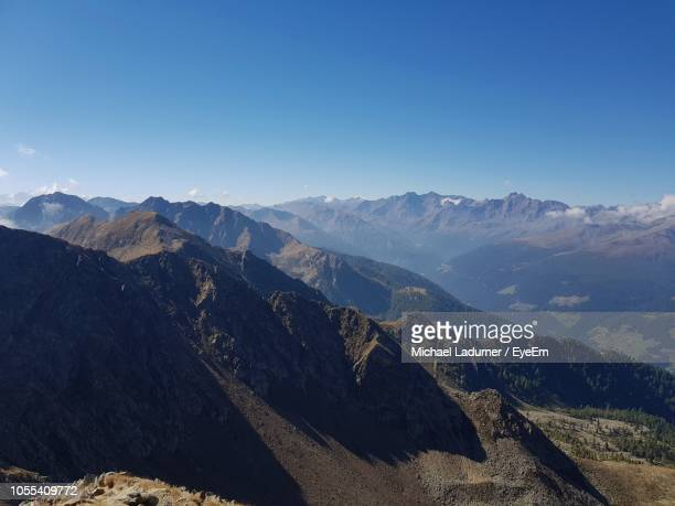 scenic view of mountains against clear blue sky - pinaceae stock pictures, royalty-free photos & images