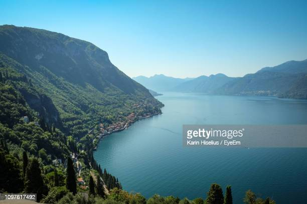 scenic view of mountains against clear blue sky - lake como stock pictures, royalty-free photos & images