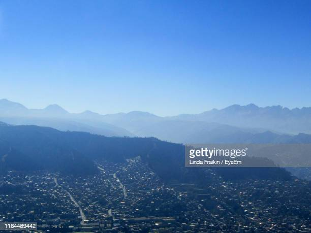 scenic view of mountains against clear blue sky - linda fraikin stock pictures, royalty-free photos & images