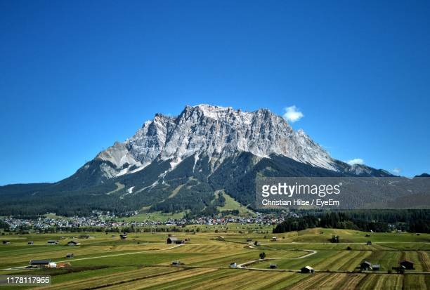 scenic view of mountains against clear blue sky - christian hilse stock-fotos und bilder