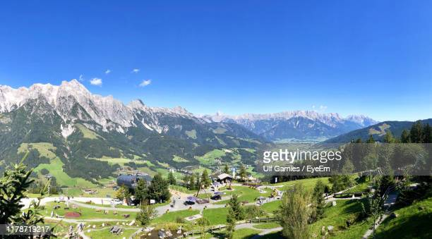 scenic view of mountains against clear blue sky - leogang stock pictures, royalty-free photos & images