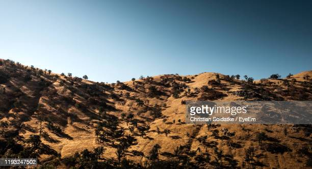 scenic view of mountains against clear blue sky - christian soldatke foto e immagini stock