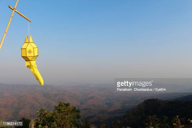 scenic view of mountains against clear blue sky - panaikorn chutidaralux stock photos and pictures