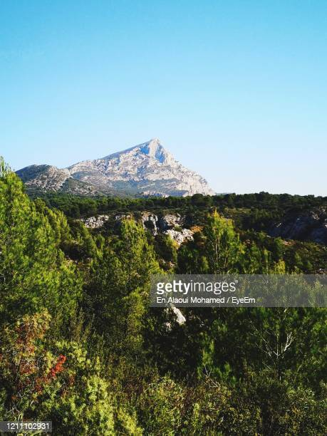 scenic view of mountains against clear blue sky - bouches du rhone stock pictures, royalty-free photos & images
