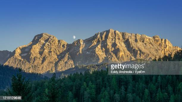 scenic view of mountains against clear blue sky - alta badia stock pictures, royalty-free photos & images
