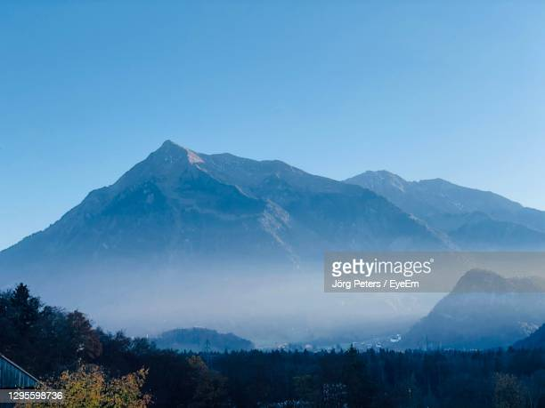 "scenic view of mountains against clear blue sky - ""jörg peters"" stock-fotos und bilder"